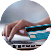 Close up of user using credit card online