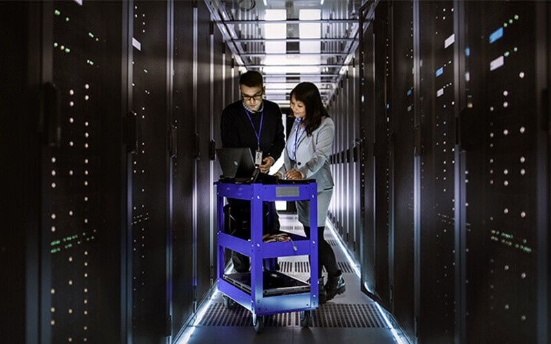 IT technicians review server information in data center