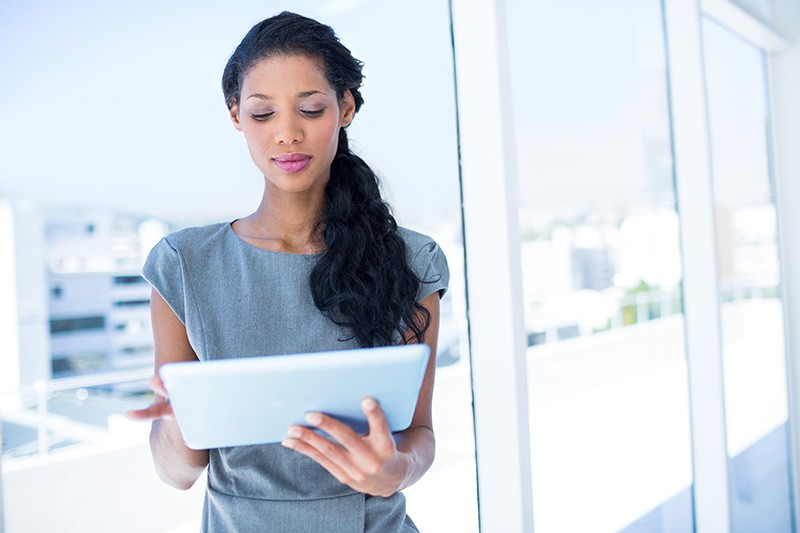 Business woman on tablet in office