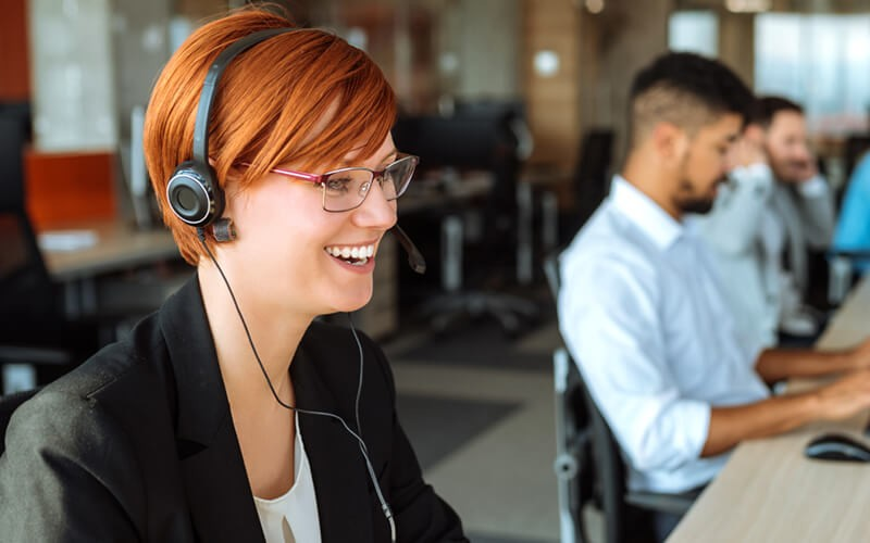 Smiling woman on headset device