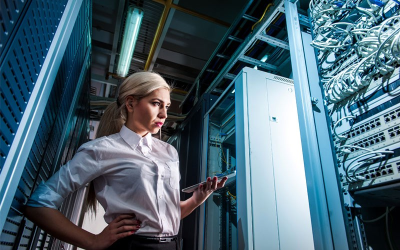 Business woman monitoring servers in data center