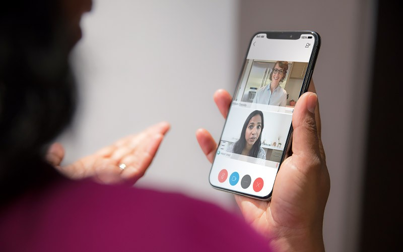 Woman on video conference call using Cisco Webex on a mobile device