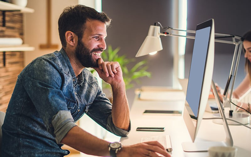 Businessman smiling on computer